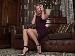 Nice blonde Lucy Lauren opens her pussy curtains and shows slit doggy style