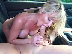 Milf loves shagging on the back seat with younger guy