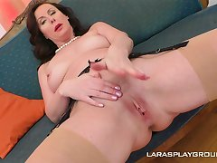 Matured glamorous devilish Lara strips with the addition of fingers herself
