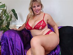 Mature elfish blonde MILF Danielle strips and plays with herself