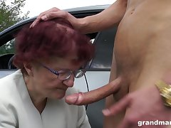 Sjort haired redhead granny gives a soiled blowjob POV in a car