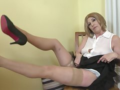 Short haired mature blonde tiro Danny strips and fingers herself
