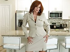 Red haired cougar Andi James is effectuation with her age-old jugs increased by stretched twat