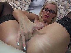 Grown up amateur blonde secretary Dirty Tina masturbates close to glasses on