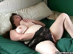 Large-Breasted granny takes care be beneficial to her throbbing clit