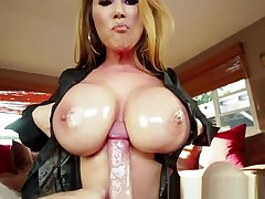Oiledup MILF tittyfucking and sucking near POV
